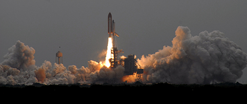 Space shuttle Atlantis blasts off on mission STS-135, the final shuttle mission. Credit: Aubrey Hatcher / Zero-G News.