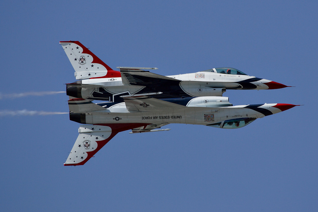 Thunderbird solo's performing a crowd pass at the 2012 Sun N' Fun Air Show.  Photo Credit:  Zero-G News / Mike Deep