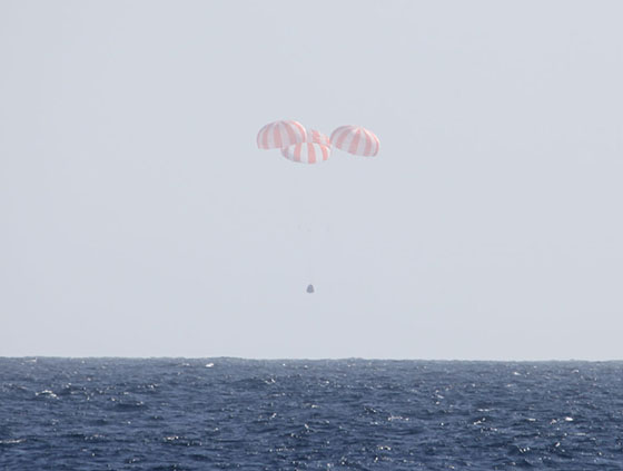 Dragon is slowed by three main parachutes prior to splashdown into the Pacific Ocean. Photo: SpaceX