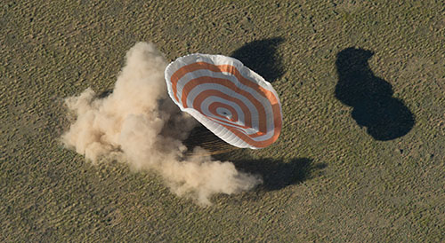 The Soyuz TMA-07M spacecraft is seen as it lands with Expedition 35 Commander Chris Hadfield of the Canadian Space Agency (CSA), NASA Flight Engineer Tom Marshburn and Soyuz Commander Roman Romanenko of the Russian Federal Space Agency (Roscosmos) in a remote area near the town of Zhezkazgan, Kazakhstan, on May 14, 2013. Hadfield, Marshburn and Romanenko returned from five months onboard the International Space Station where they served as members of the Expedition 34 and 35 crews. Photo Credit: NASA/Carla Cioffi