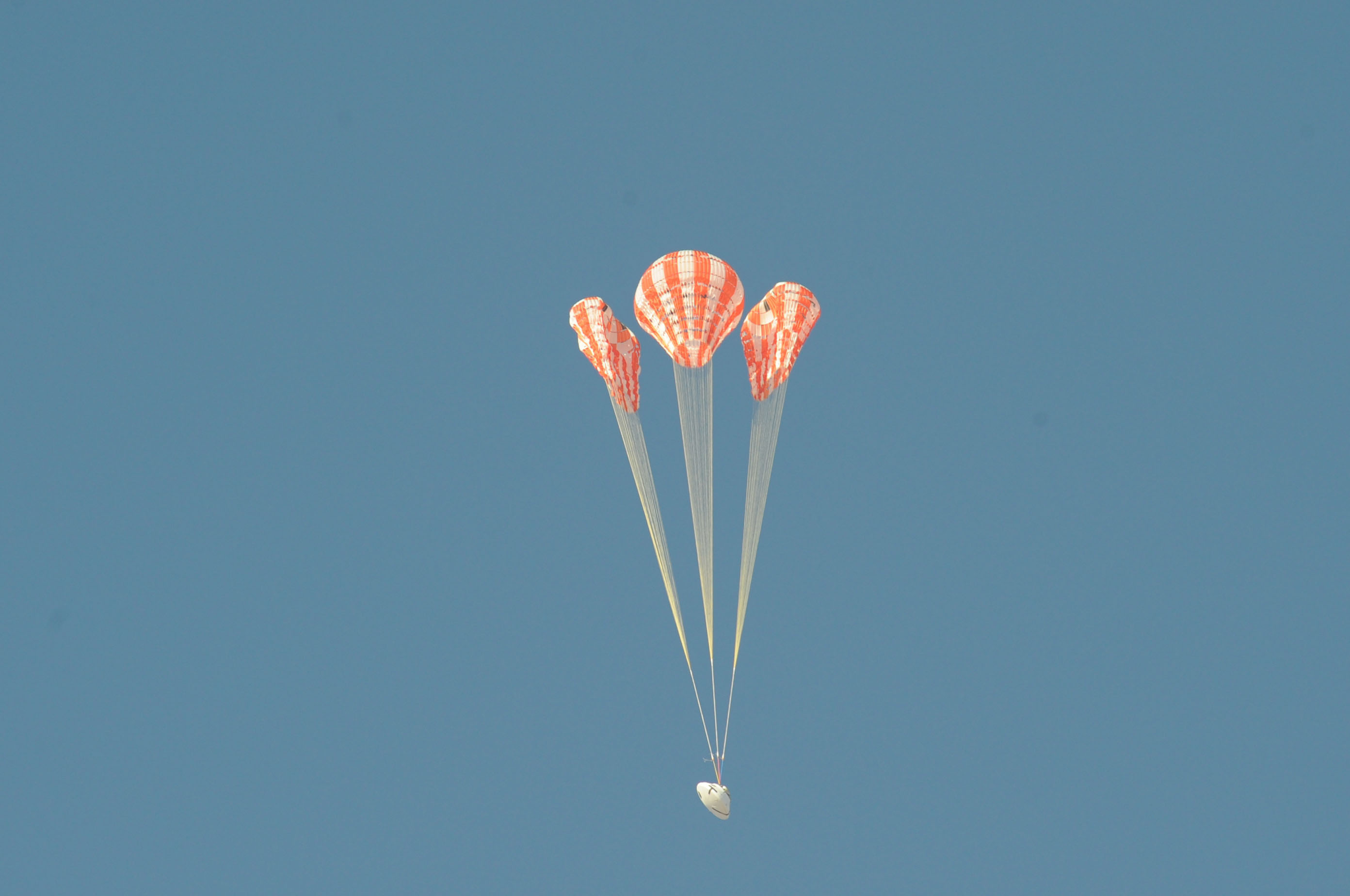 To test the Orion parachute system, engineers rigged one of the test capsule's three main parachutes – the middle parachute in this view – to skip one stage of its inflation, putting additional stress on the vehicle as it opened. Testing irregularities allows engineers to verify the parachutes are reliable even when something goes wrong. The information gathered during the test can help refine models used to build the system and Orion.