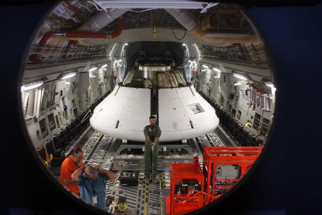 A model of NASA's Orion spacecraft is loaded into the C-17 airplane that then dropped it from an altitude of 25,000 feet above the Arizona dessert. The test took place at the U.S. Army's Yuma Proving Ground in Yuma, Ariz., on Wednesday, May 1.