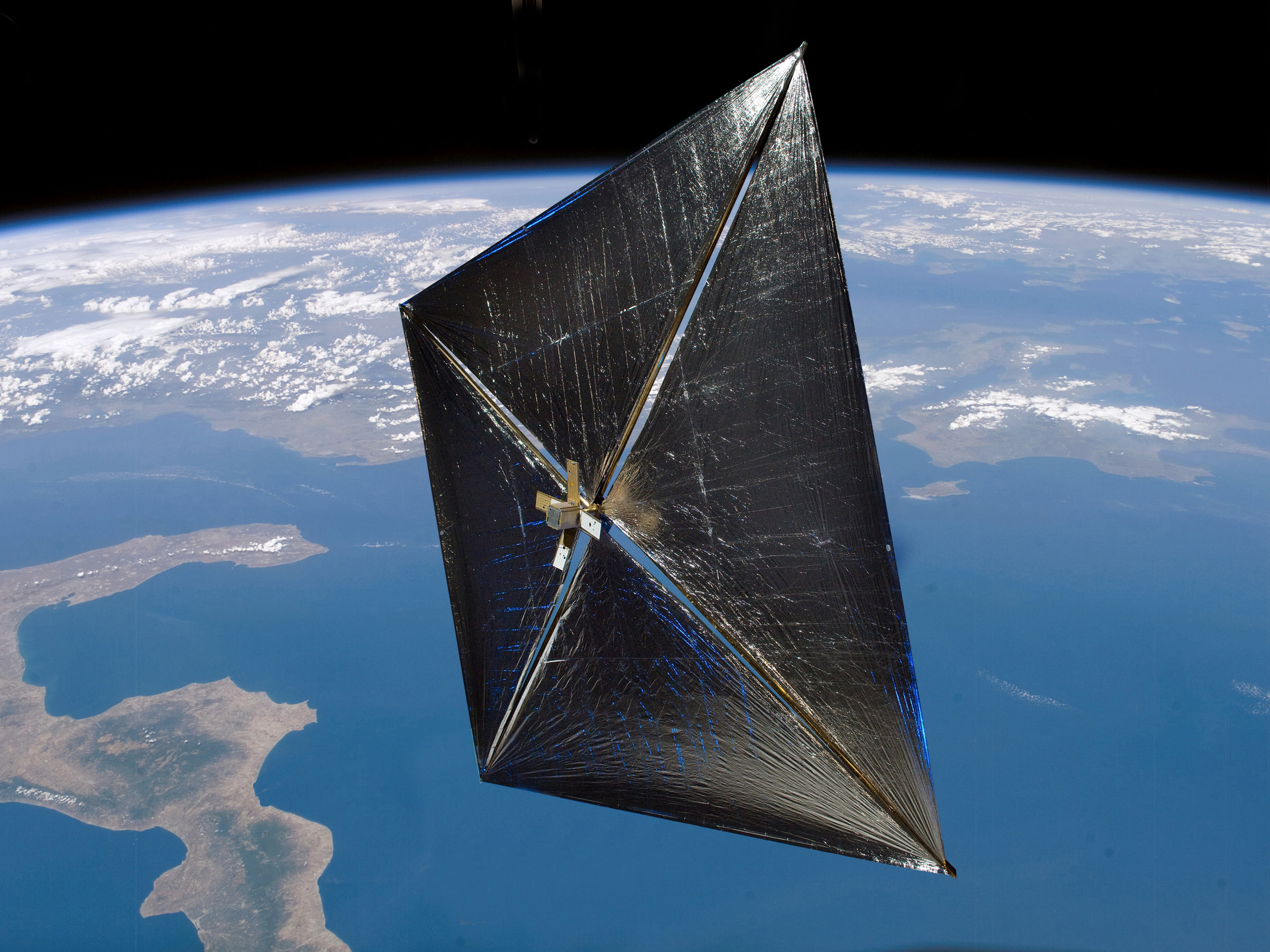 Artist's depiction of NASA's NanoSail-D2 solar sail-powered cubesat in Earth orbit. Credit: NASA