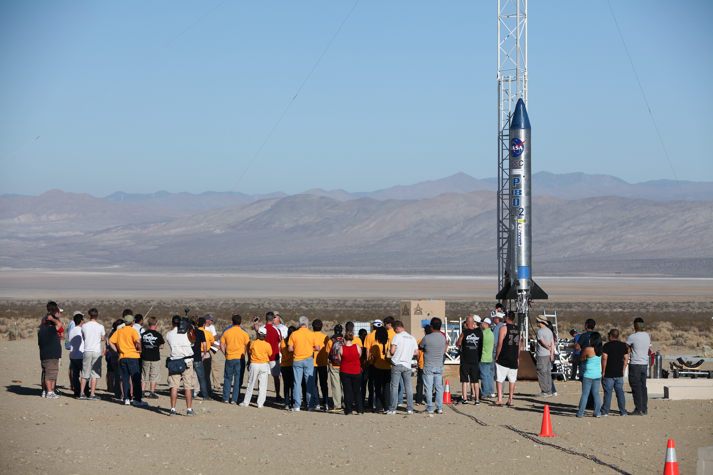 Image above: Students and engineers participate in a prelaunch briefing before liftoff of the Prospector 18 rocket. Photo credit: NASA/Dimitri Gerondidakis