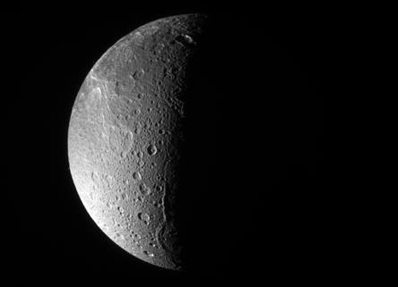 The Cassini spacecraft looks down, almost directly at the north pole of Dione. The feature just left of the terminator at bottom is Janiculum Dorsa, a long, roughly north-south trending ridge. Image credit: NASA/JPL/Space Science Institute.