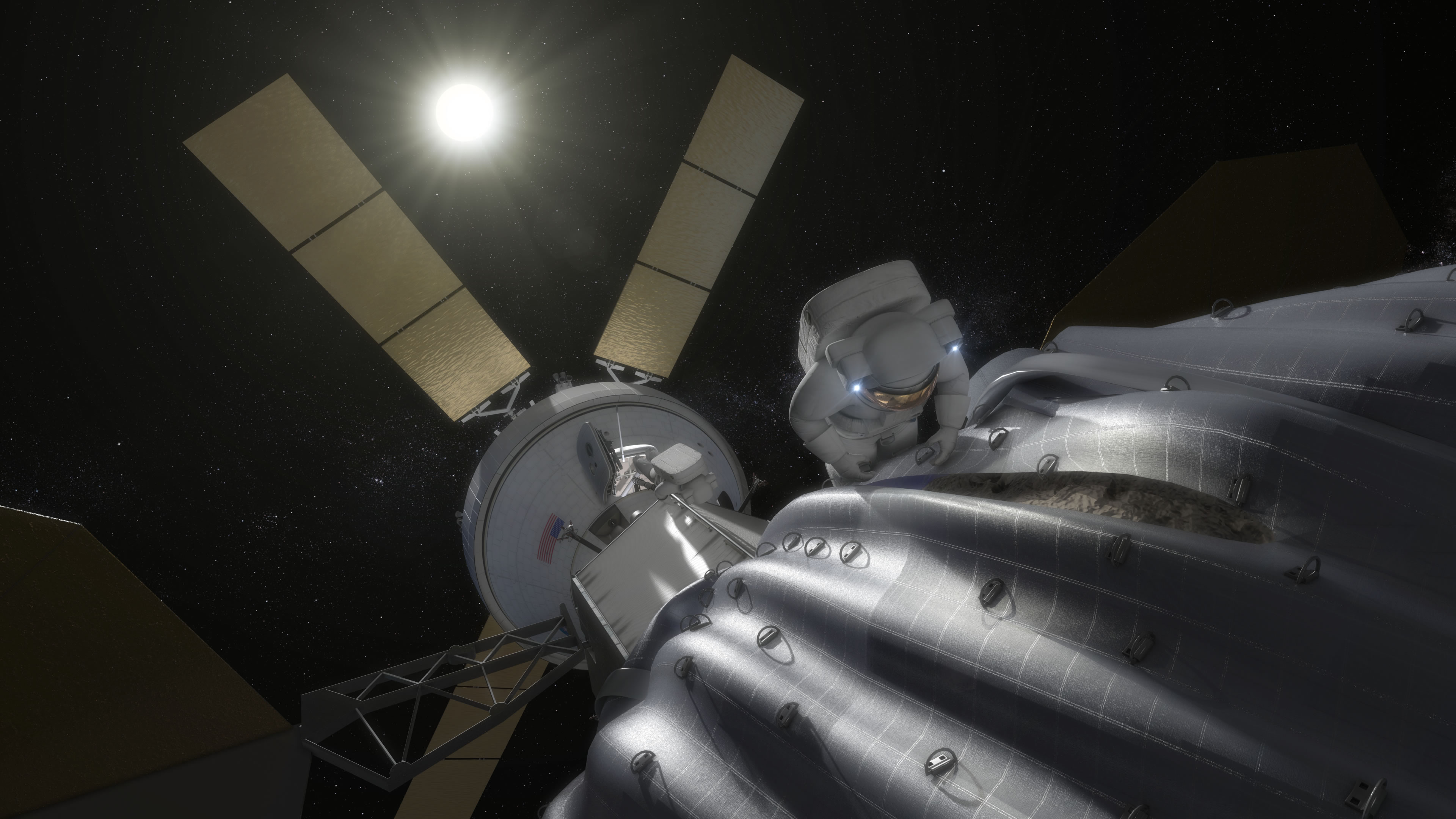 This concept image shows an astronaut preparing to take samples from the captured asteroid after it has been relocated to a stable orbit in the Earth-moon system. Hundreds of rings are affixed to the asteroid capture bag, helping the astronaut carefully navigate the surface. Image Credit: NASA
