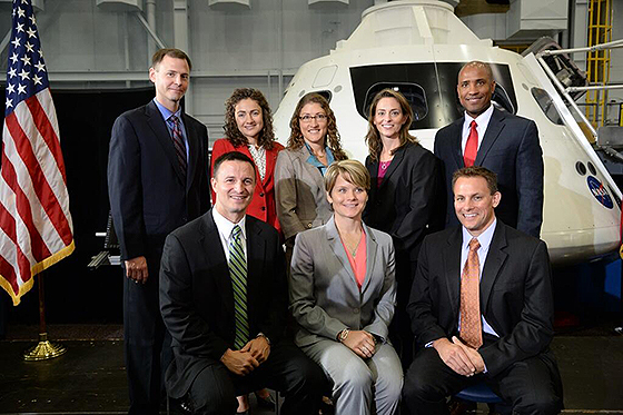 Members of NASA's newest astronaut class pose with an Orion capsule at NASA's Johnson Space Center in Houston on Tuesday, Aug. 20, 2013. Pictured back row, left to right: Tyler (Nick) Hague, Jessica Meir, Christina Hammock, Nicole Mann, Victor Glover. Picture front row, left to right: Andrew Morgan, Anne McClain, Josh Cassada. Image Credit: NASA