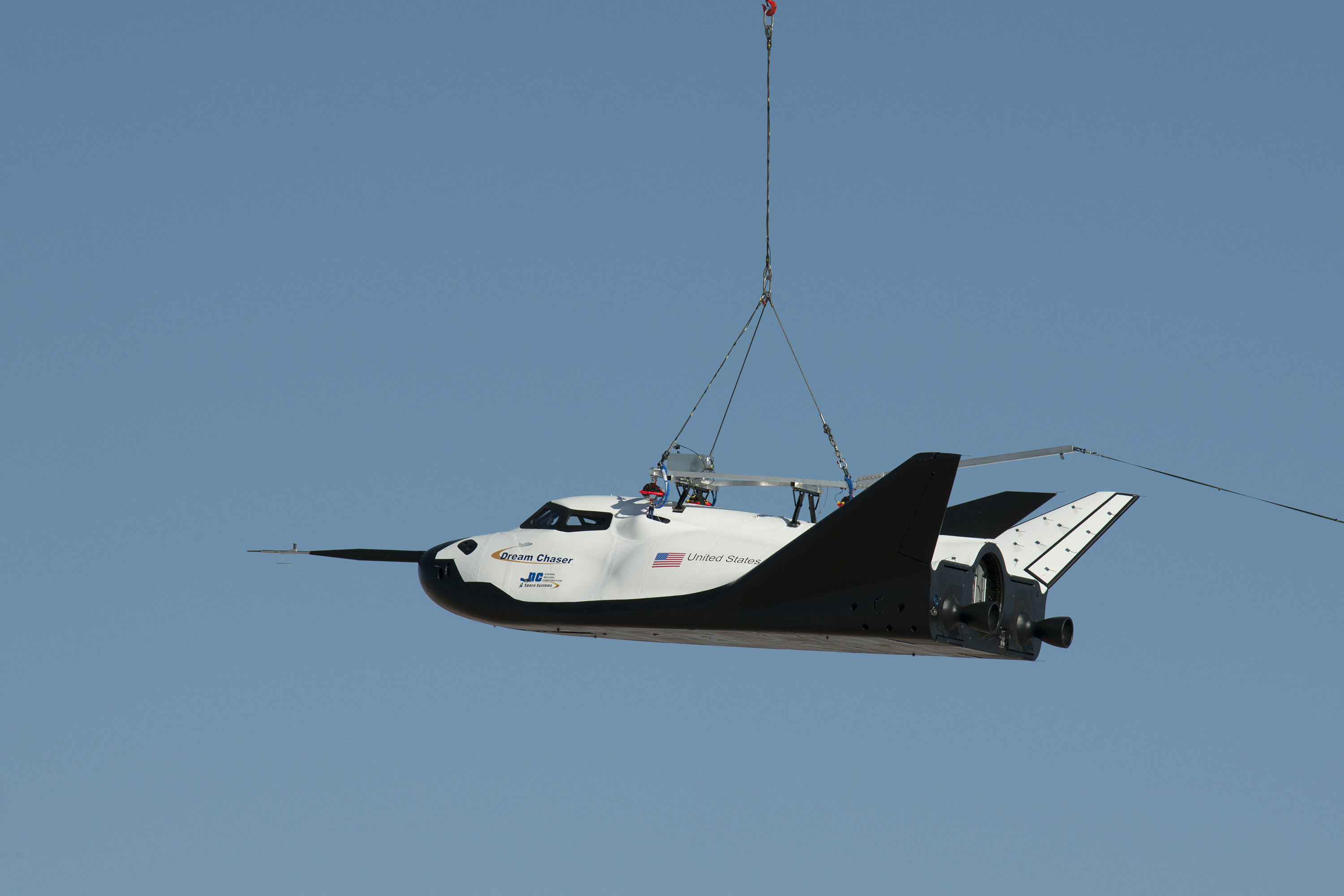NASA partner Sierra Nevada Corporation (SNC) of Louisville, Colo., performs a captive-carry test of the Dream Chaser spacecraft Thursday at NASA's Dryden Flight Research Center in Edwards, Calif. Image Credit: NASA