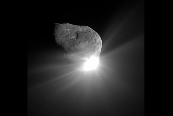 This spectacular image of comet Tempel 1 was taken 67 seconds after it obliterated Deep Impact's impactor spacecraft. The image reveals topographic features, including ridges, scalloped edges and possibly impact craters formed long ago. Image credit: NASA/JPL-Caltech/UMD