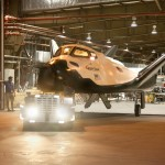 The Sierra Nevada Corporation, or SNC, Dream Chaser flight vehicle pulls out of a hangar at NASA's Dryden Flight Research Center in California in preparation for tow tests. Ground testing at 10, 20, 40 and 60 miles per hour is helping the company validate the performance of the spacecraft's braking and landing systems prior to captive-carry and free-flight tests scheduled for later this year. SNC is continuing the development of its Dream Chaser spacecraft under the agency's Commercial Crew Development Round 2, or CCDev2, and Commercial Crew Integrated Capability, or CCiCap, phases, which are intended to lead to the availability of commercial human spaceflight services for government and commercial customers. To learn more about CCP and its industry partners, visit www.nasa.gov/commercialcrew. Image credit: NASA/Ken Ulbrich