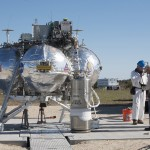 A technician monitors the flow of propellant loading in the Project Morpheus prototype lander as it is prepared for its third free flight test at the north end of the Shuttle Landing Facility at NASA's Kennedy Space Center in Florida. The 57-second test began at 1:15 p.m. EST with the Morpheus lander launching from the ground over a flame trench and ascending about 187 feet, nearly doubling the target ascent velocity from the last test in December 2013. The lander flew forward, covering about 154 feet in 20 seconds before descending and landing within 11 inches of its target on a dedicated pad inside the autonomous landing and hazard avoidance technology, or ALHAT, hazard field. Project Morpheus tests NASA's ALHAT and an engine that runs on liquid oxygen and methane, or green propellants, into a fully-operational lander that could deliver cargo to other planetary surfaces. The landing facility provides the lander with the kind of field necessary for realistic testing, complete with rocks, craters and hazards to avoid. Morpheus' ALHAT payload allows it to navigate to clear landing sites amidst rocks, craters and other hazards during its descent. Project Morpheus is being managed under the Advanced Exploration Systems, or AES, Division in NASA's Human Exploration and Operations Mission Directorate. The efforts in AES pioneer new approaches for rapidly developing prototype systems, demonstrating key capabilities and validating operational concepts for future human missions beyond Earth orbit. For more information on Project Morpheus, visit http://www.nasa.gov/centers/johnson/exploration/morpheus. Photo credit: NASA/Kim Shiflett