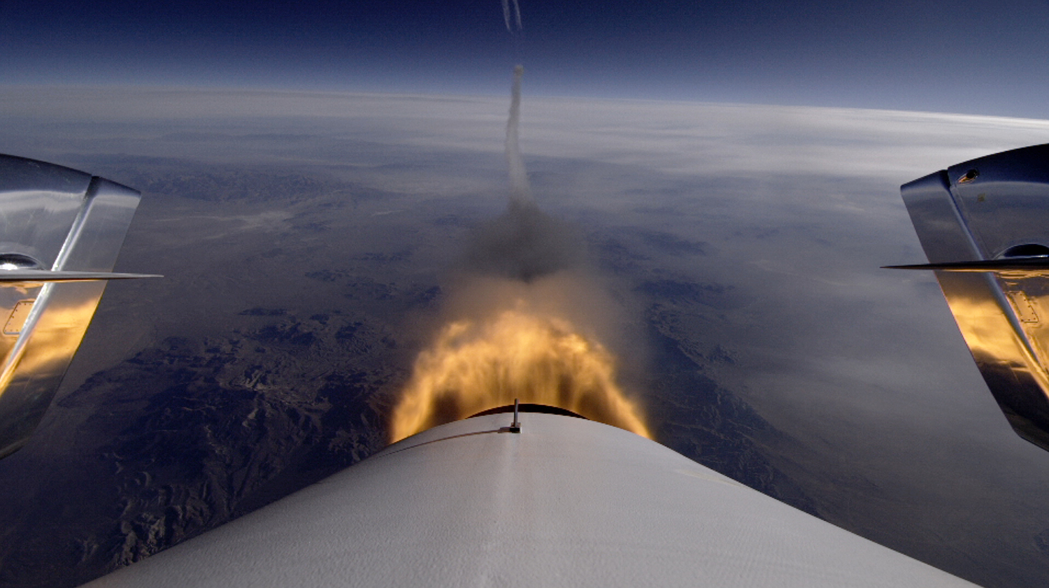 SpaceShipTwo ignites its engine to begin its third supersonic test flight. Photo Credit: Virgin Galactic.