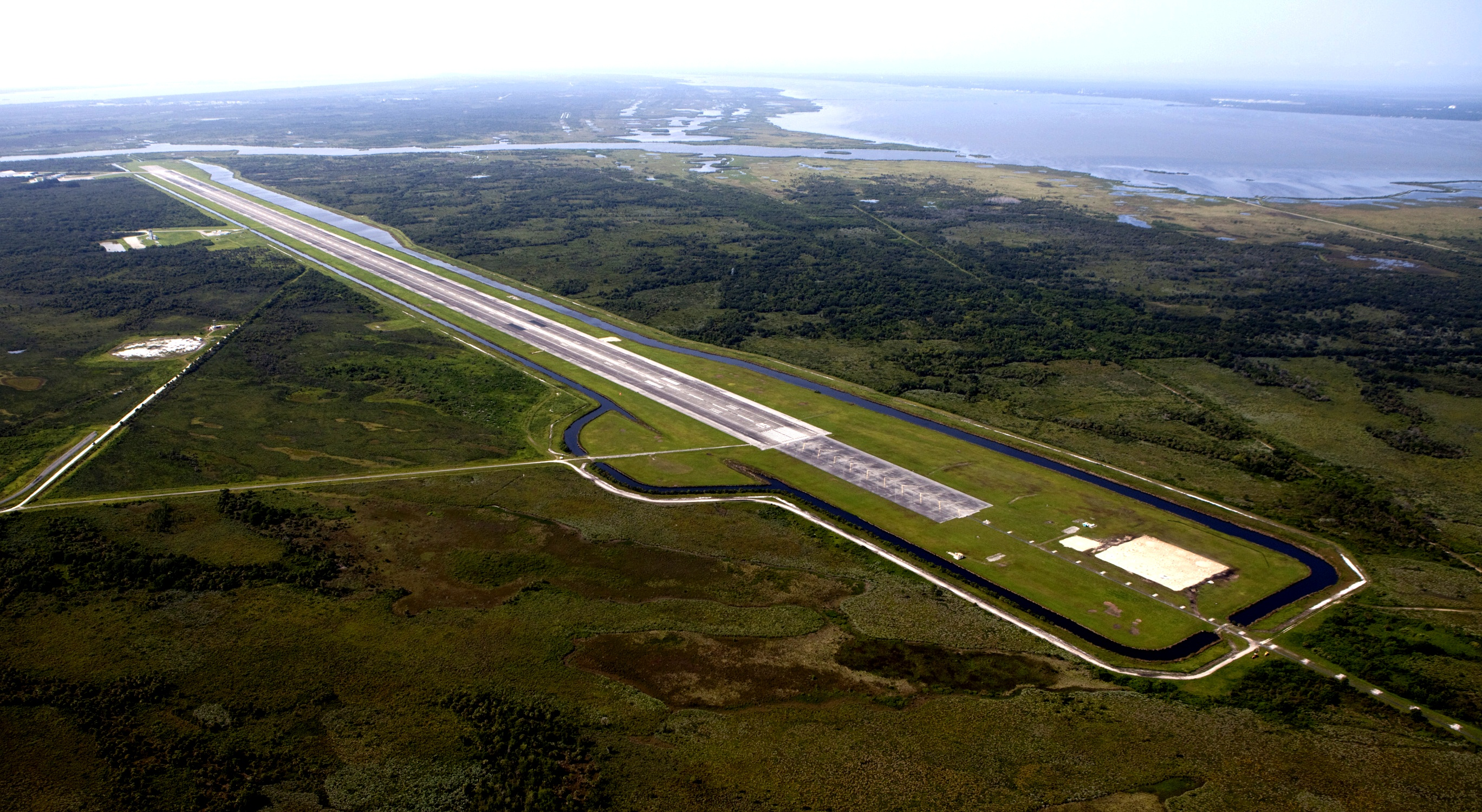 The 15,000-foot long Shuttle Landing Facility at the Kennedy Space Center was photographed in this aerial view on July 19, 2012. What once served as the runway where space shuttles returned to Earth may soon be the site of vehicles launching horizontally on sub-orbital space flights. Image Credit: NASA/Kim Shiflett