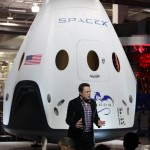 SpaceX CEO and founder Elon Musk unveils the Dragon V2 during a ceremony for the new spacecraft inside SpaceX headquarters in Hawthorne, Calif. The spacecraft is designed to carry people into Earth's orbit and was developed in partnership with NASA's Commercial Crew Program under the Commercial Crew Integrated Capability agreement. SpaceX is one of NASA's commercial partners working to develop a new generation of U.S. spacecraft and rockets capable of transporting humans to and from Earth's orbit from American soil. Ultimately, NASA intends to use such commercial systems to fly U.S. astronauts to and from the International Space Station. Photo credit: NASA/Dimitri Gerondidakis