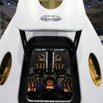 A look through the open hatch of the Dragon V2 reveals the layout and interior of the seven-crew capacity spacecraft. SpaceX unveiled the new spacecraft during a ceremony at its headquarters in Hawthorne, Calif. The Dragon V2 is designed to carry people into Earth's orbit and was developed in partnership with NASA's Commercial Crew Program under the Commercial Crew Integrated Capability agreement. SpaceX is one of NASA's commercial partners working to develop a new generation of U.S. spacecraft and rockets capable of transporting humans to and from Earth's orbit from American soil. Ultimately, NASA intends to use such commercial systems to fly U.S. astronauts to and from the International Space Station. Photo credit: NASA/Dimitri Gerondidakis