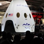 The Dragon V2 stands on a stage inside SpaceX headquarters in Hawthorne, Calif., during its unveiling ceremony. The spacecraft is designed to carry people into Earth's orbit and was developed in partnership with NASA's Commercial Crew Program under the Commercial Crew Integrated Capability agreement. SpaceX is one of NASA's commercial partners working to develop a new generation of U.S. spacecraft and rockets capable of transporting humans to and from Earth's orbit from American soil. Ultimately, NASA intends to use such commercial systems to fly U.S. astronauts to and from the International Space Station. Photo credit: NASA/Dimitri Gerondidakis