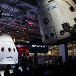The Dragon V2 stands on a stage inside SpaceX headquarters in Hawthorne, Calif., near a suspended cargo-carrying Dragon spacecraft that flew a previous mission. The new spacecraft, the Dragon V2, is designed to carry people into Earth's orbit and was developed in partnership with NASA's Commercial Crew Program under the Commercial Crew Integrated Capability agreement. SpaceX is one of NASA's commercial partners working to develop a new generation of U.S. spacecraft and rockets capable of transporting humans to and from Earth's orbit from American soil. Ultimately, NASA intends to use such commercial systems to fly U.S. astronauts to and from the International Space Station. Photo credit: NASA/Dimitri Gerondidakis