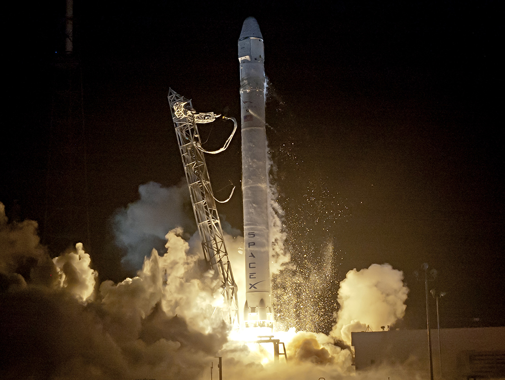 A SpaceX Falcon 9 rockets blasts off on  the CRS-1 mission to resupply ISS.