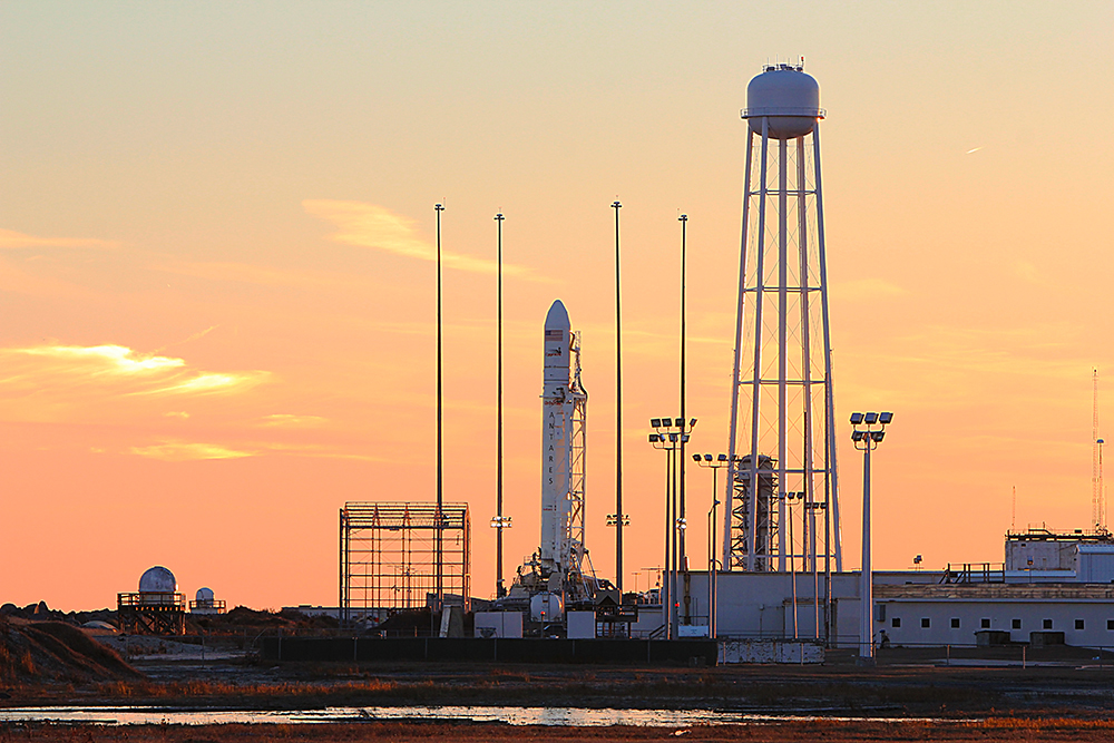 Antares rocket with the Cygnus ISS resupply craft sits on the launch pad at Wallops Island, VA before the Orb-1 mission.
