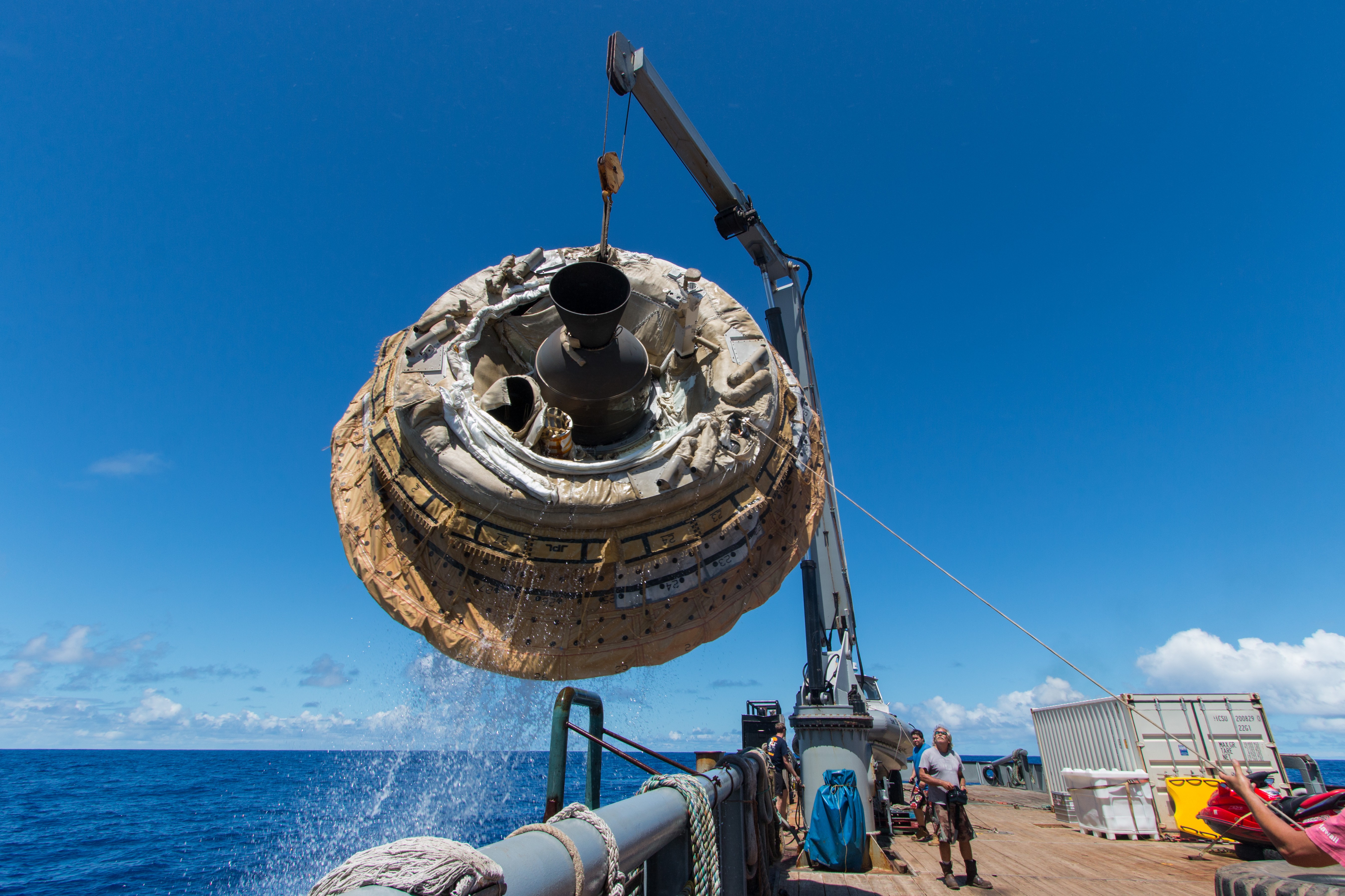 Hours after the June 28, 2014, test of NASA's Low-Density Supersonic Decelerator over the U.S. Navy's Pacific Missile Range, the saucer-shaped test vehicle is lifted aboard the Kahana recovery vessel. Image Credit: NASA/JPL-Caltech