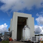 NASA and United Launch Alliance workers rolled out the first fully-assembled Orion spacecraft for a move to the facility where it will be fueled up for its December launch on the Exploration Flight Test 1 (EFT-1) mission. Photo Credit: Matthew Travis / Zero-G News