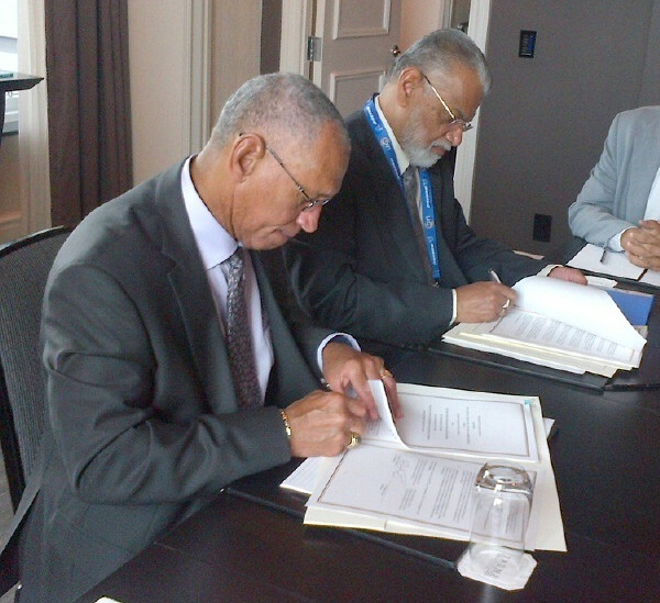 NASA Administrator Charles Bolden (left) and Chairman K. Radhakrishnan of the Indian Space Research Organisation signing documents in Toronto on Sept. 30, 2014 to launch a joint Earth-observing satellite mission and establish a pathway for future joint missions to explore Mars. Image Credit: NASA