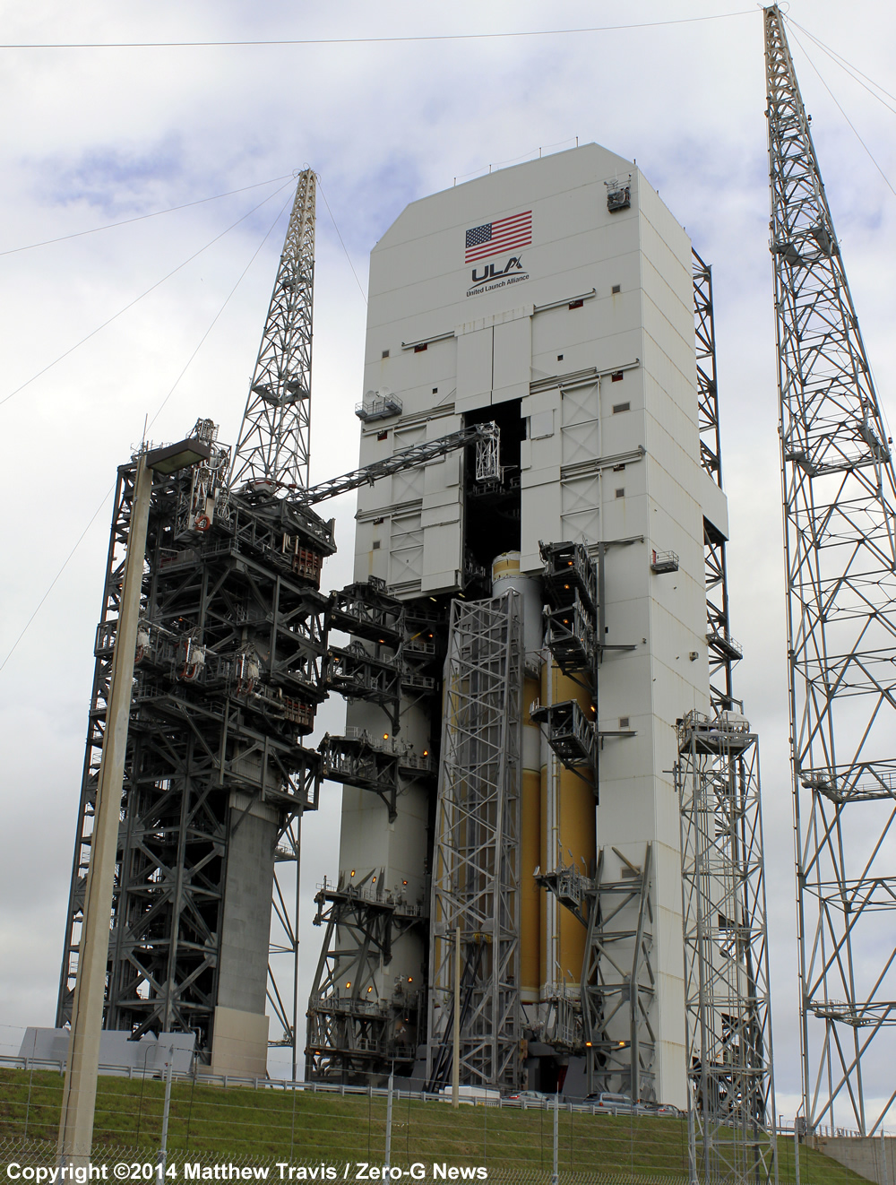 NASA looks to the future as workers raise a United Launch Alliance Delta 4 rocket on the pad at Space Launch Complex 37. This Delta vehicle will power the first test flight of NASA's Orion spacecraft, the first human spacecraft designed to travel beyond low Earth orbit since the Apollo program. Launch of Exploration Flight Test 1 (EFT-1) is targeted for the morning of December 4. Photo Credit: Matthew Travis / Zero-G News