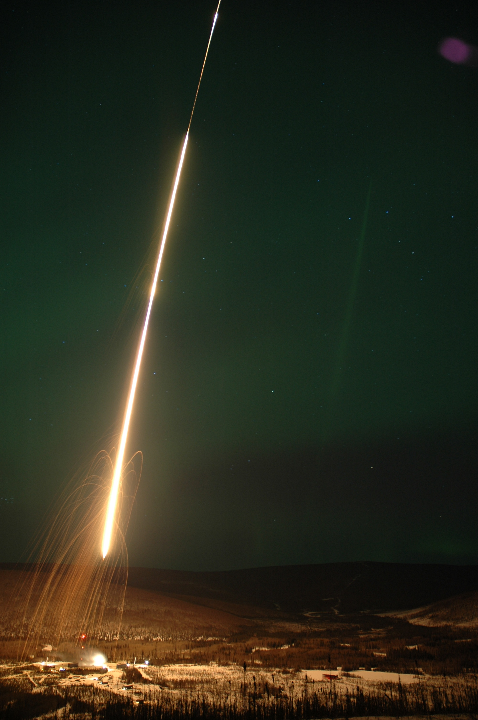 A NASA sounding rocket leaves the launch pad at the Poker Flat Research Range, Alaska, during a 2007 campaign. Image Credit: NASA