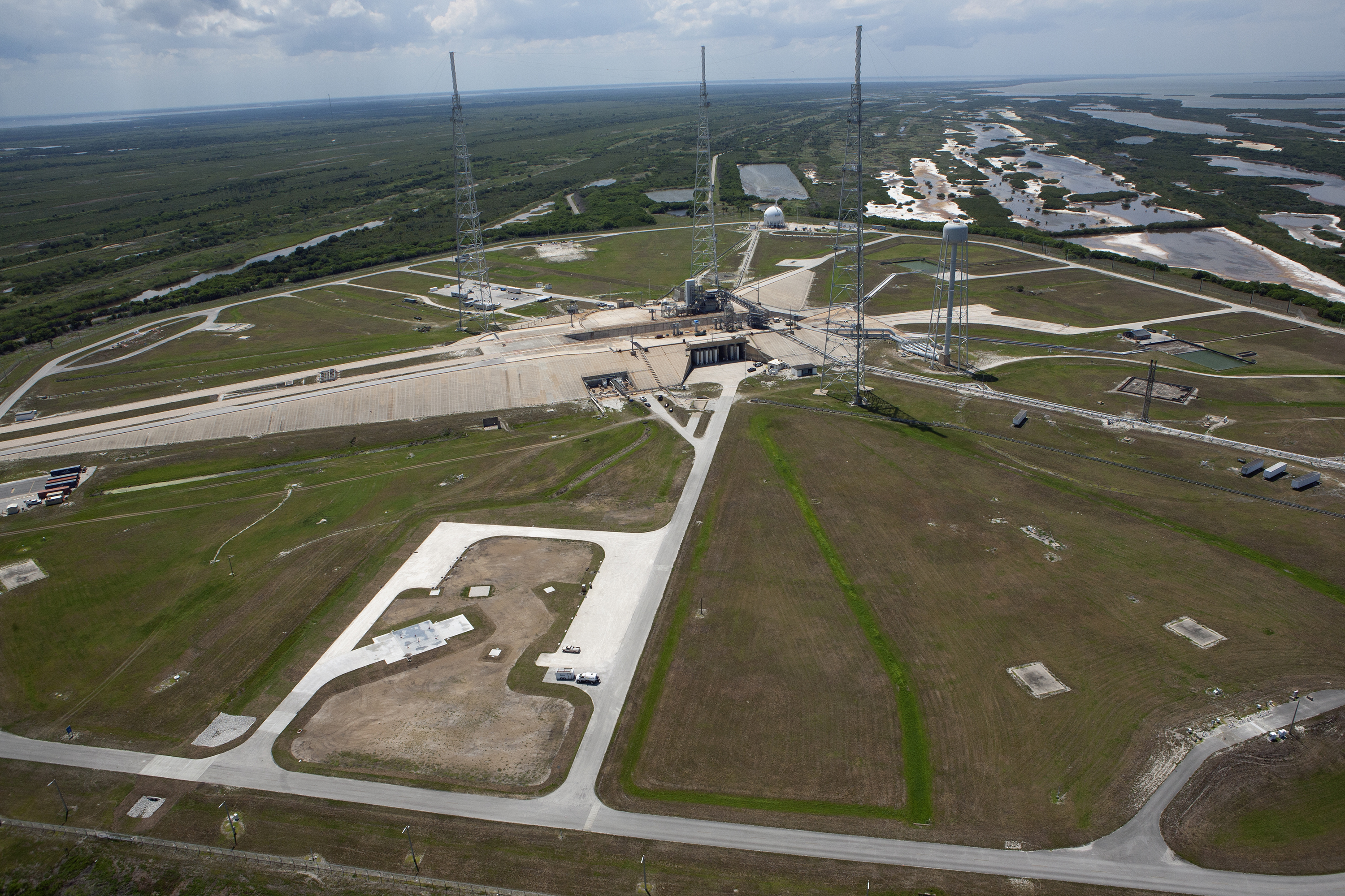 An aerial view of Pad 39C within the perimeter of Pad 39B at NASA's Kennedy Space Center in Florida.A computer-aided aerial image of Launch Pad 39B, and the new Small Class Vehicle Launch Pad, designated Pad 39C, in the southeast area of the perimeter of pad B. Credits: NASA/David Zeiters