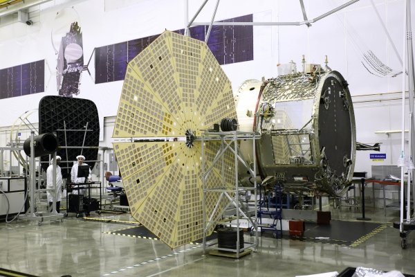 The OA-4 Service Module (SM) undergoing deployment testing of one of its two Ultraflex solar arrays at Orbital ATK's Dulles, Virginia Satellite Manufacturing Facility. Orbital ATK's Space Components Division supplies the Ultraflex arrays. (courtesy: Orbital ATK)