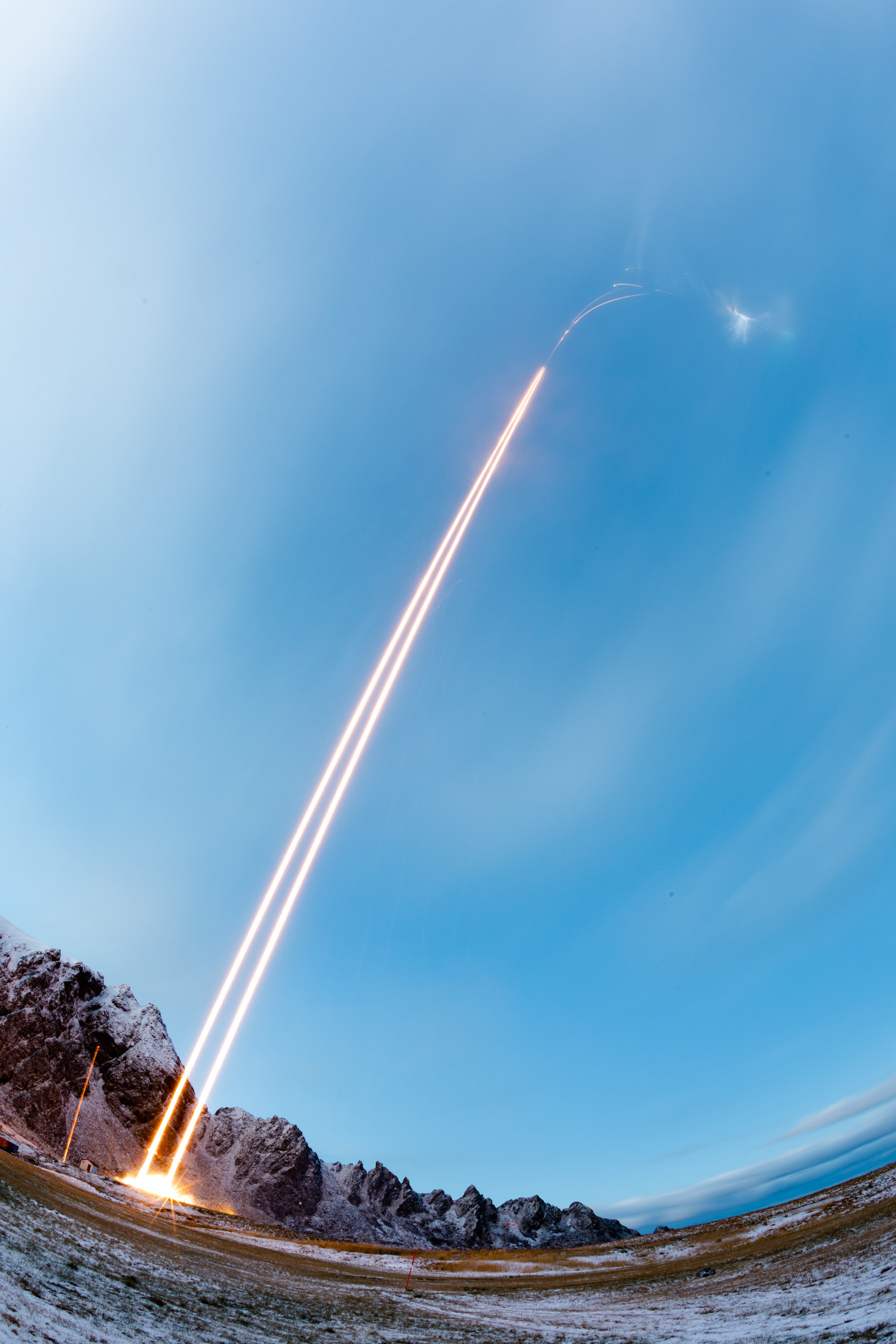 The two TRICE-2 Black Brant XII sounding rockets are seen in this time-lapse photograph soaring into space over the Norwegian Sea. Credits NASA/Jamie Adkins